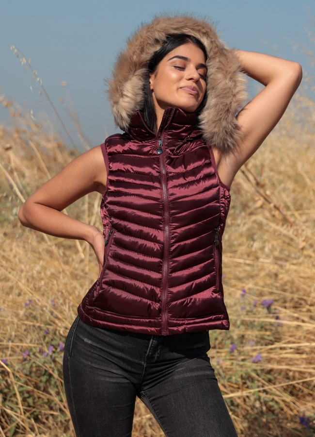 sleeveless shiny jacket with fur on the hood